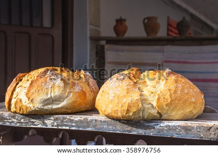 Pieces of crispy bread over wood table - stock photo