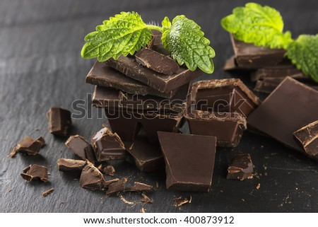 Pieces of dark chocolate and mint - stock photo
