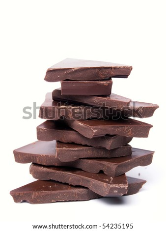 Pieces of dark chocolate on white background.