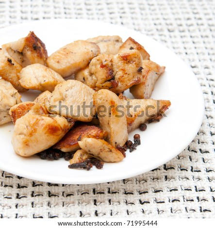 pieces of delicious fried chicken on a white plate - stock photo