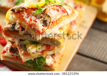 Pieces of delicious pizza on the table, close-up