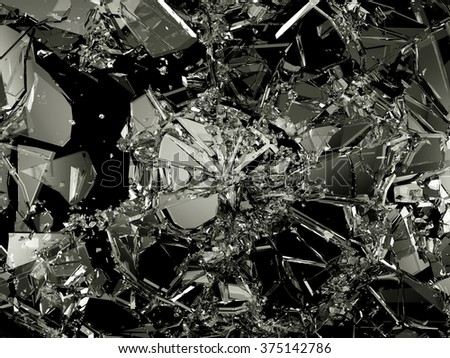 Pieces of destructed Shattered glass on black. Large resolution - stock photo