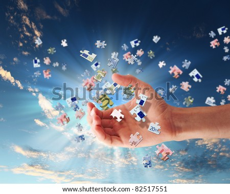 pieces of euro banknote puzzle getting together - stock photo