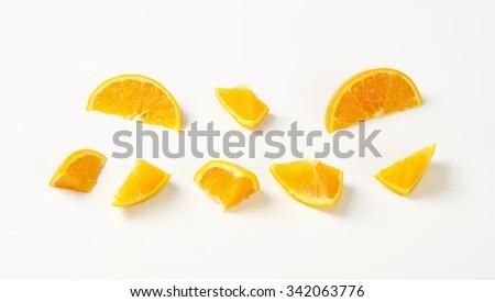 pieces of fresh orange on white background - stock photo