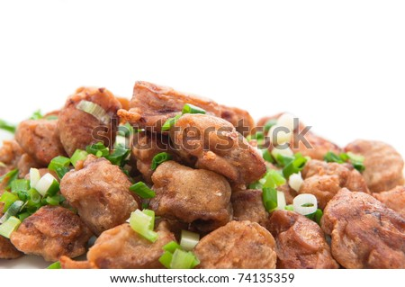 Pieces of fried breaded pork loin with green onion