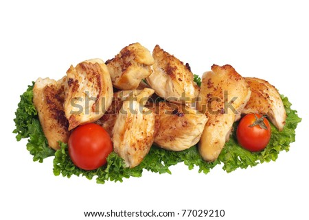 Pieces of fried chicken isolated on white - stock photo