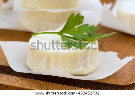 pieces of goat cheese with green parsley