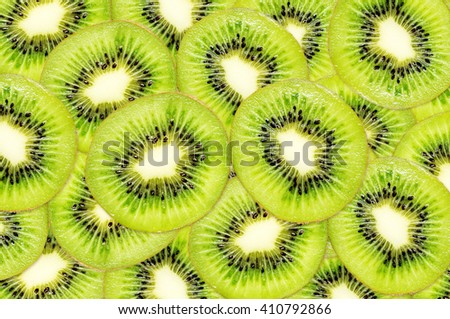 Pieces of kiwi fruits for background. - stock photo