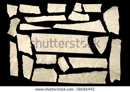 Pieces of masking tape on black - stock photo