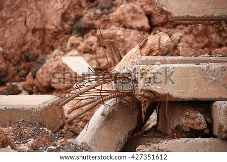 Pieces of Metal and Stone are Crumbling from Demolished Building  - stock photo