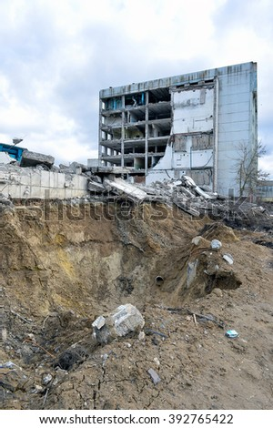 Pieces of Metal and Stone are Crumbling from Demolished Building Floors - stock photo