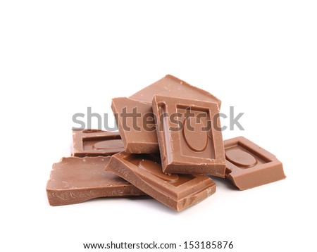 Pieces of milk chocolate on white background