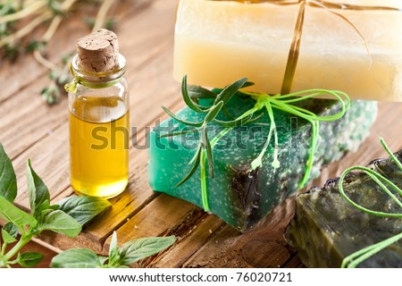 Pieces of natural soap with oil and herbs. - stock photo