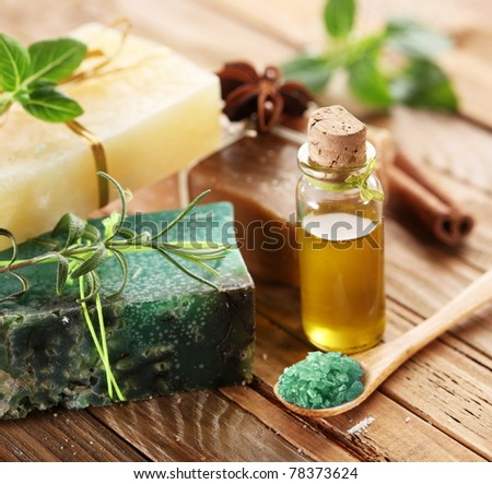Pieces of natural soap with salt, herbs and oil.