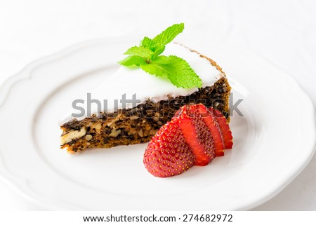 Pieces of nut cake with strawberry - stock photo