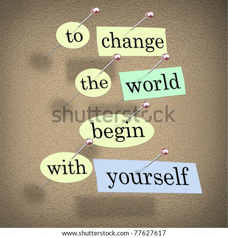 Pieces of paper each containing a word pinned to a cork board reading To Change the World Begin With Yourself - stock photo