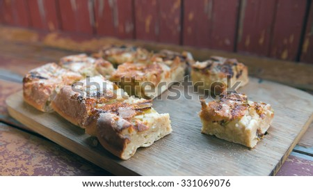 pieces of pear pie on   wooden board on   table.  - stock photo