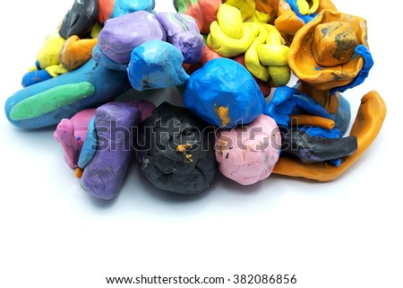 Pieces of plasticine, isolated on white background. Focus on front pieces. Space for texts.