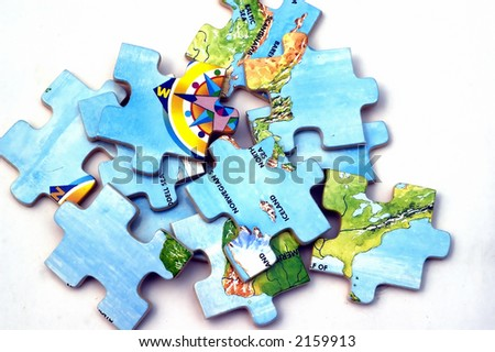 Pieces of Puzzle lying against a white background - stock photo