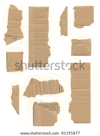 pieces of ripped or torn cardboard on an isolated white background - stock photo