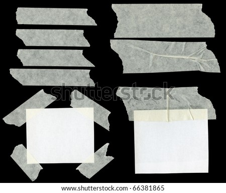 Pieces of sticky paper on black background