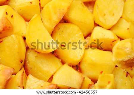 Pieces of tasty roast  potato close up - stock photo