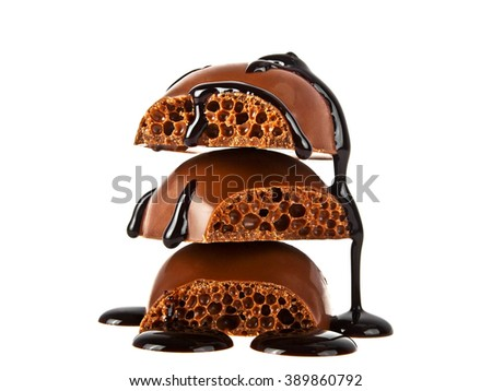Pieces of tile porous milk chocolate poured chocolate isolated on white background - stock photo