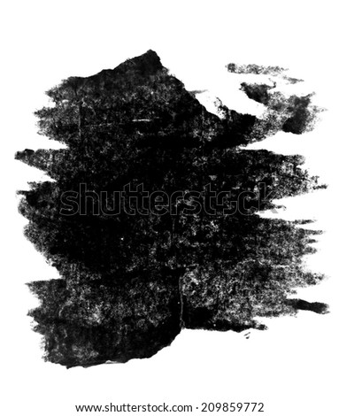 Pieces of torn black paper on white