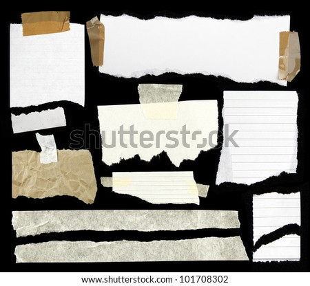 Pieces of torn paper and adhesive tape on black - stock photo