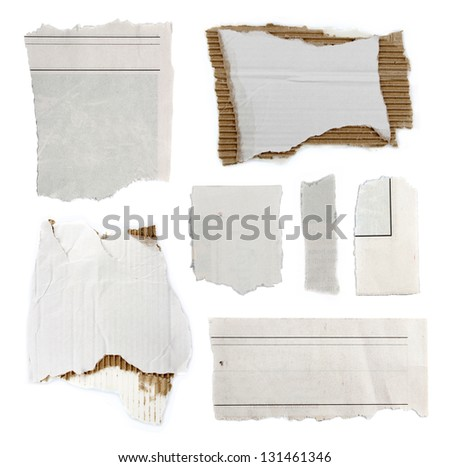 Pieces of torn paper and cardboard on plain background. Copy space - stock photo