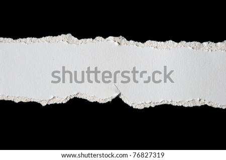 Pieces of torn paper isolated on black - stock photo