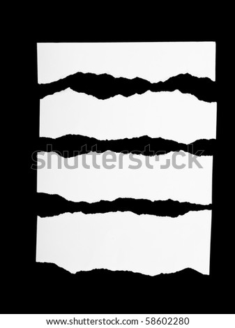 Pieces of torn white paper on black - stock photo