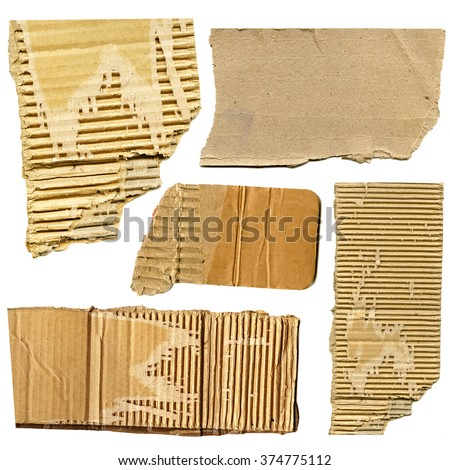 piecies of aged torn cardboard isolated on white background - stock photo