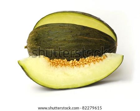 Piel de sapo melon and a slice on white background - stock photo