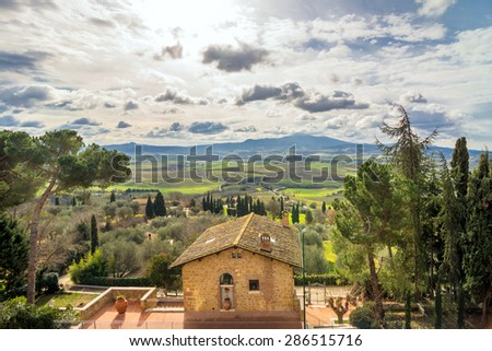 PIENZA, ITALY - January 25, 2015: panoramic view of Val dOrcia valley from Pienza, Italy. In 2004 the Val dOrcia was added to the UNESCO list of World Heritage Sites