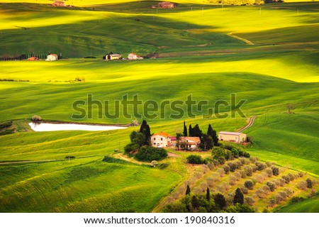 Pienza Val d Orcia, rural sunset landscape. Countryside farm and green fields. Tuscany, Italy, Europe. - stock photo