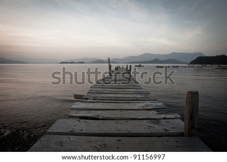 pier and boat with sunset