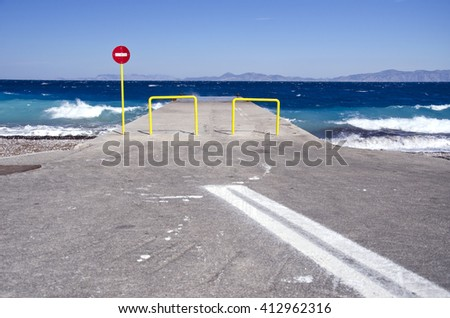 Pier and car parking lot by the sea in Rhodes, Greece - stock photo