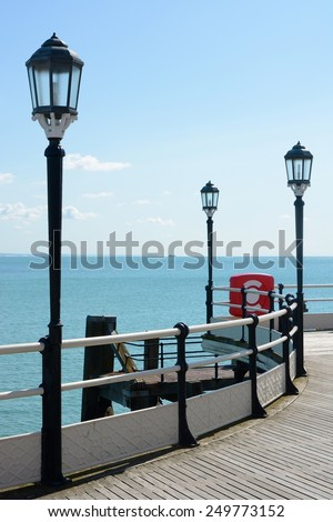 Pier and sea at Worthing, West Sussex, England. With lamps and railings - stock photo