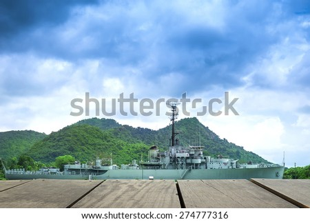Pier and warship sailing into the sea for background usage - stock photo