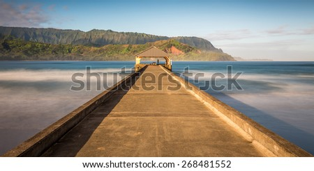 Pier at Hanalei bay, kauai. Long exposure with early morning sunlight - stock photo