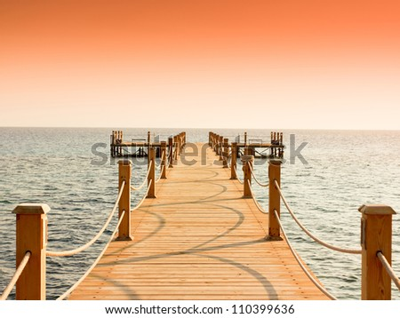 Pier at Heavenly Sunset - stock photo