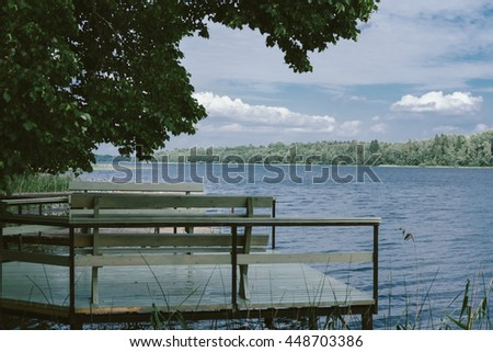 Pier at the lake in the summer - stock photo