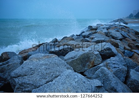 Pier/Breakwater at Rayong beach in dusk, Thailand. - stock photo