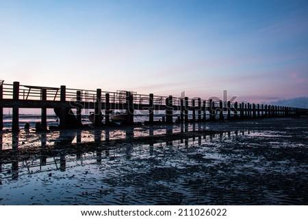 Pier,Bridge to sea silhouette - stock photo