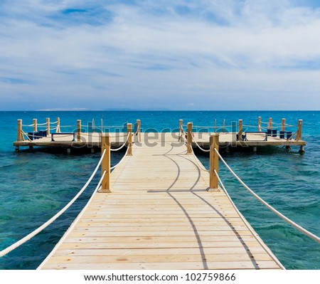 Pier in Heavenly Blue Place - stock photo