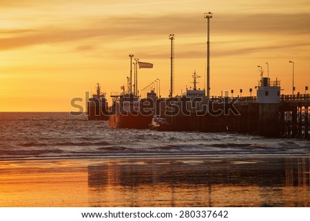 Pier in Puerto Madryn at sunset, Patagonia, Argentina - stock photo