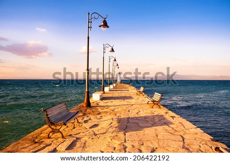 Pier in the evening - Pefkohori, Greece - stock photo