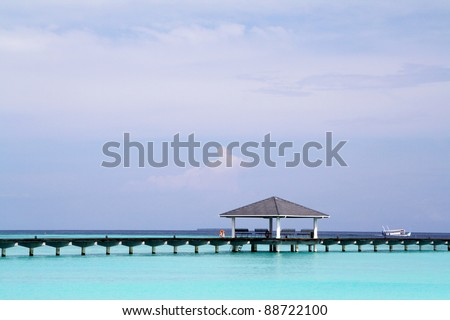 Pier in tropical sea - stock photo