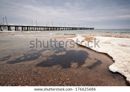 Pier, jetty on the sea - ice - floe. Poland, Gdynia - stock photo